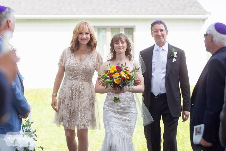 Bride walks down aisle at Thompson Island.