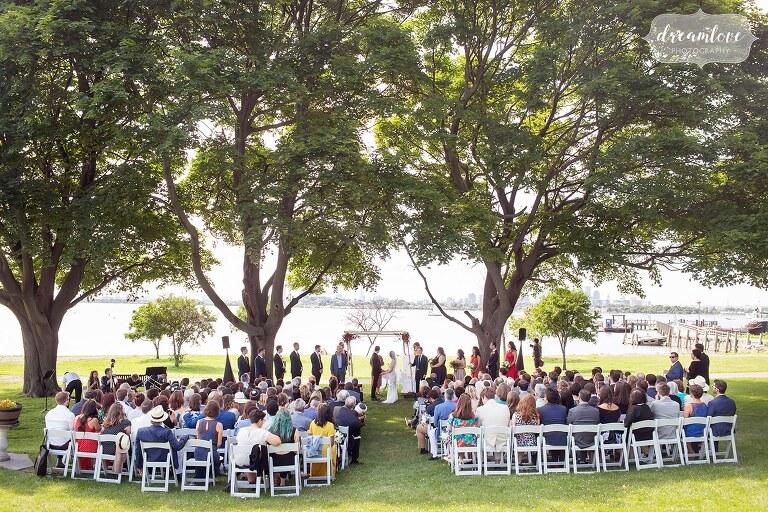 Stunning coastal outdoor wedding ceremony overlooking Boston Harbor.
