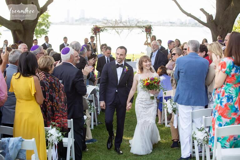 Happy bride and groom exit ceremony on Thompson Island.