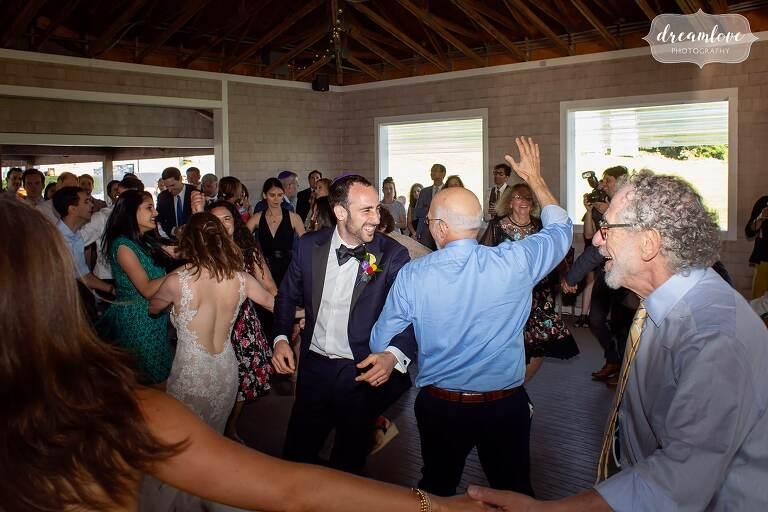 Jewish wedding hora dance at Thompson Island Boston wedding.