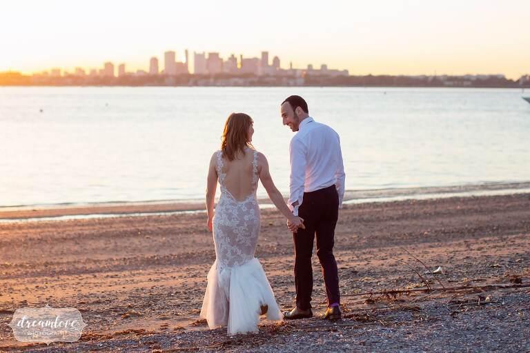 Warm tones wedding photography of bride and groom on Boston beach.