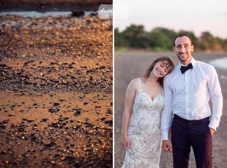 Bride and groom cuddle on Thompson Island beach in Boston.