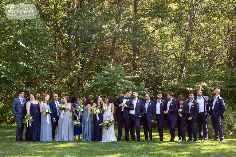 Large wedding party poses at the Hidden Pond Resort in Maine.