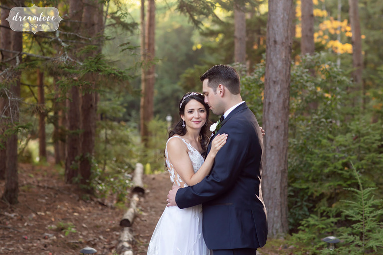 Bride and groom in the forest in Maine.