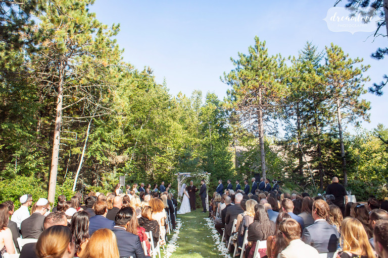 Bride and groom at their outdoor ceremony at the Hidden Pond Resort.