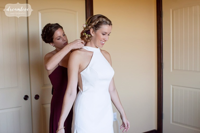 Bride puts on dress at Stratton Mountain.