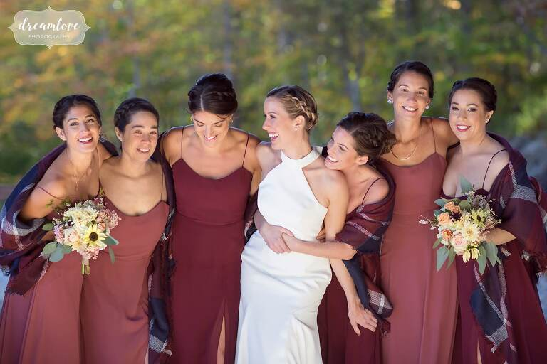 Bride surrounded by her bridesmaids at Stratton Mountain in VT.