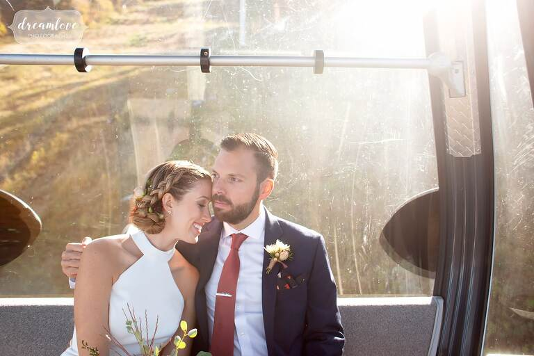 Bride and groom cuddling in the gondola at Stratton Mountain Resort.
