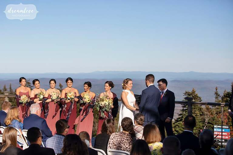 Bride and groom on mountaintop ceremony at Stratton Resort in VT.