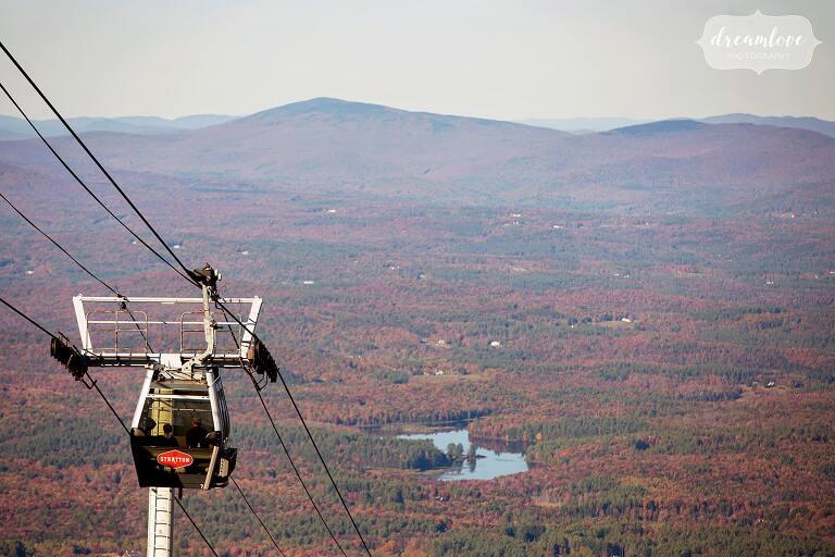 Stratton Mountain gondola ride through fall foliage mountains.