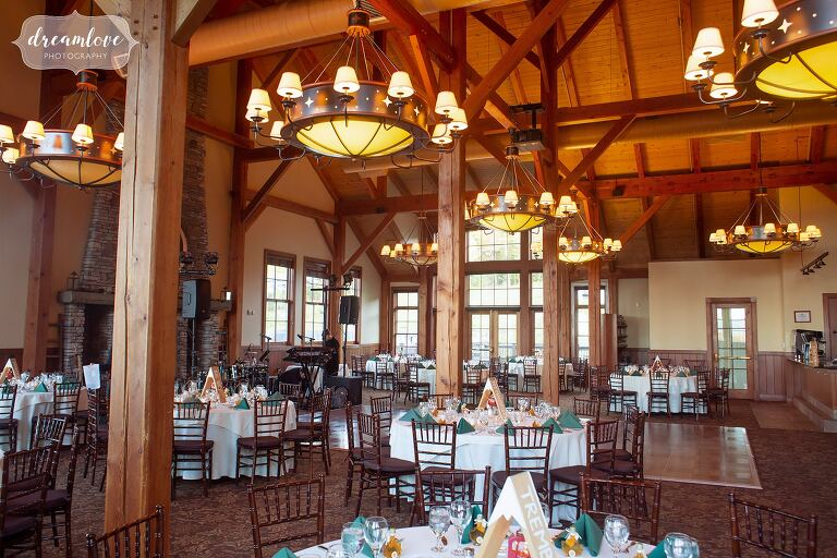 Rustic dinner table wedding reception set up inside of Stratton Mountain Lodge.