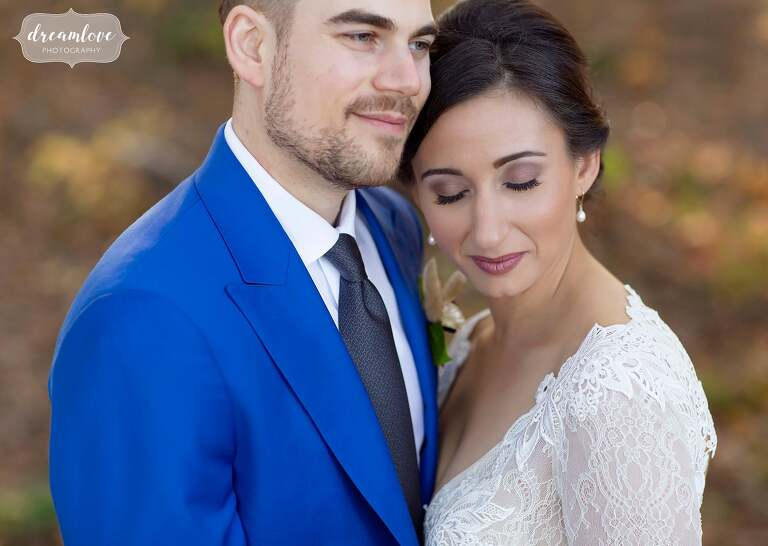Romantic wedding photo with groom in bright blue suit at Zukas Barn.