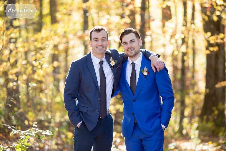 Happy groomsmen in blue suits at Zukas Hilltop Barn.