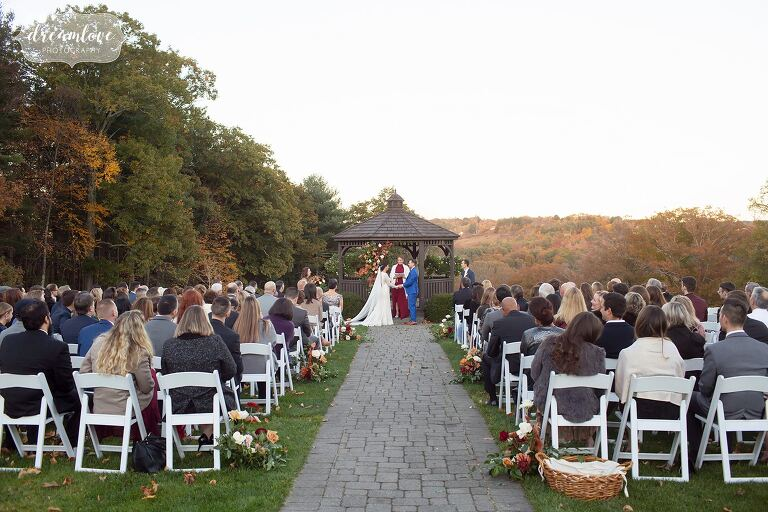 Beautiful outdoor ceremony with fall foliage at Zukas Hilltop Barn in central MA.