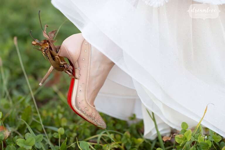 Funny Christian Louboutin bridal sparkle pumps with fall leaves gathered.