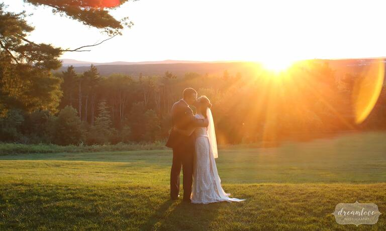 Bride and groom on sunset at the Fruitlands Museum wedding venue in Harvard, MA.