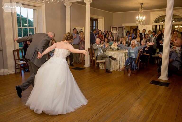 The bride and groom finish their first dance in the ballroom at the Lyman Estate.