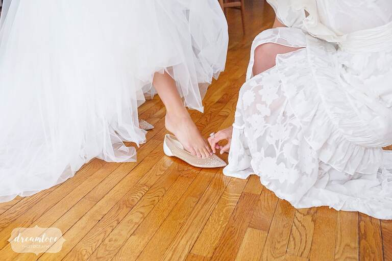 Bride puts on sparkly Louboutin flats for her wedding in CT.
