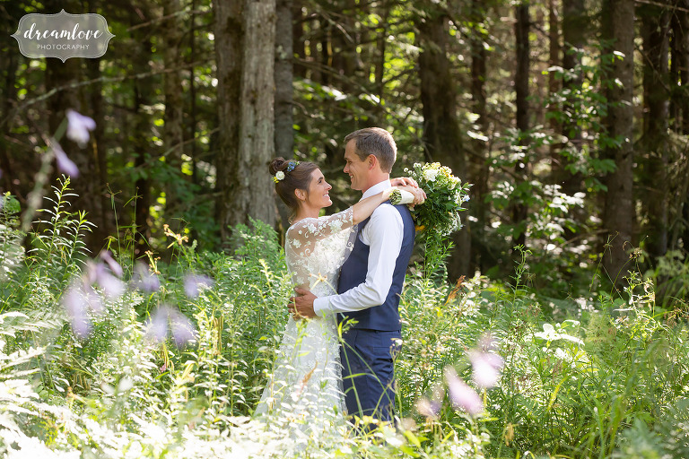 Bride and groom in the woods at their Stowe Meadows summer wedding in VT.