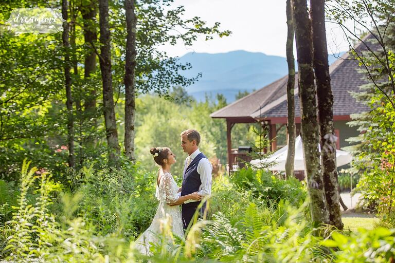 Stowe wedding photographer captures couple in woods with mountains.