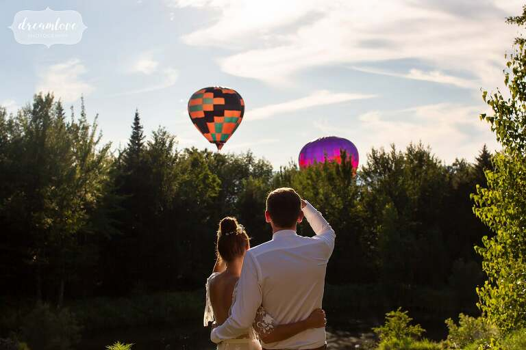 Couple watches hot air balloons for Stowe, VT wedding.