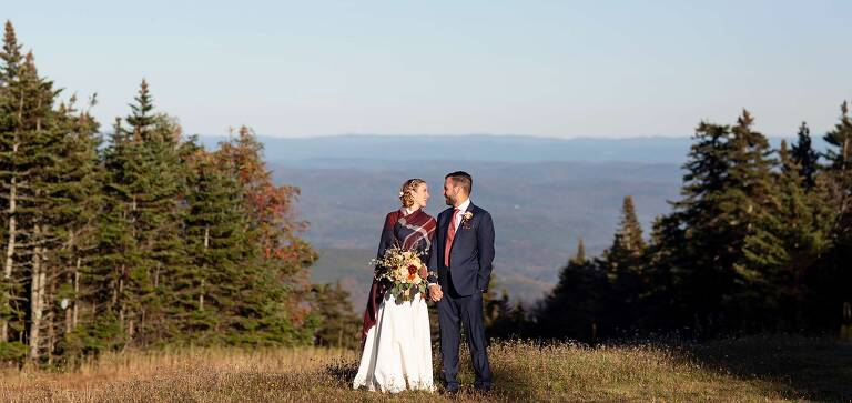 bride and groom on top of stratton mountain