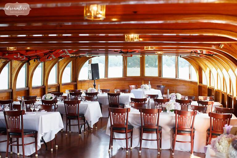 Inside view of the Horicon, a Lake George wedding venue boat with beautiful wood.