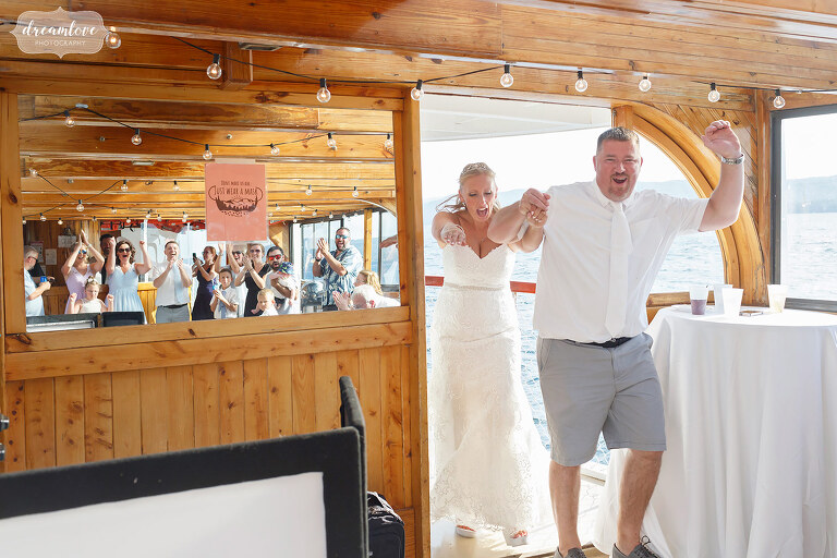 Couple enters wedding reception on Horicon Boat in NY.