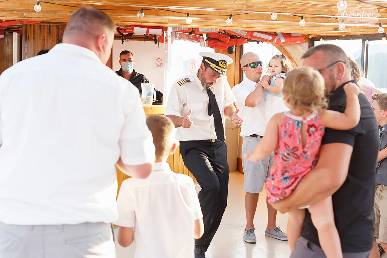 Funny image of Captain of Horicon party boat dancing at wedding reception on Lake George.