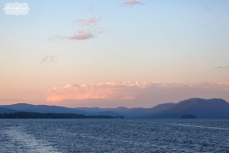 View of Adirondacks at dusk on Lake George from wedding boat.