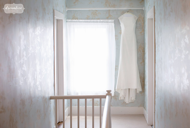 Bride's dress hanging at the Myopia Hunt Club in MA.